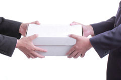 Businessman give white box gift. To customer with white background Stock Photo