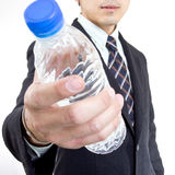 Businessman give you water for drink Royalty Free Stock Photography