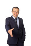 Businessman gives a handshake Stock Images