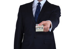 Businessman gives the money Stock Photo