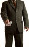Businessman gives money Royalty Free Stock Images