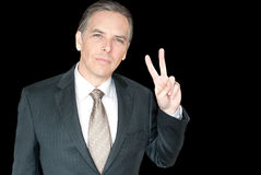 Businessman Gives Peace Sign Royalty Free Stock Photography