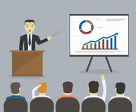 Businessman gives a presentation or seminar. Business meeting, t Royalty Free Stock Photography
