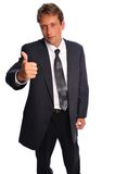 Businessman gives thumbs up Royalty Free Stock Photo