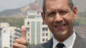 Businessman Gives Thumbs Up Stock Photo