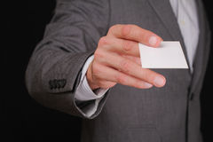 Businessman Giving a Business Card. Business meeting, negotiations, partnership concept Royalty Free Stock Images