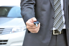 Businessman giving a car key - car sale & rental business concept Royalty Free Stock Photos