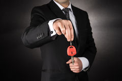 Businessman giving a car key Stock Photography
