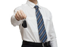 Businessman giving a car key Royalty Free Stock Photos