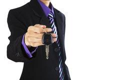 A businessman giving a car key Royalty Free Stock Photo