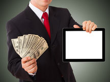 Businessman giving cash dollars in the hands Stock Images