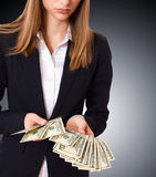 Businessman giving cash dollars in the hands Stock Photography