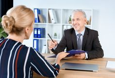 Businessman giving contract to partner Royalty Free Stock Photo
