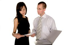 Businessman is giving document to a businesswoman Stock Images