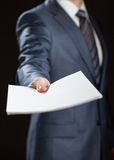 Businessman giving documents to you Royalty Free Stock Images