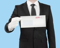 Businessman giving a envelope Royalty Free Stock Image