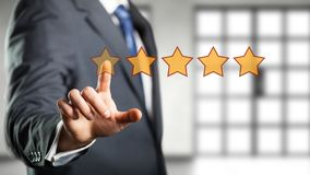 Businessman giving a five star rating stock photography