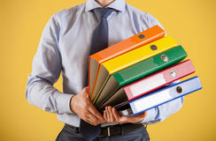 Businessman giving folders to you Royalty Free Stock Images