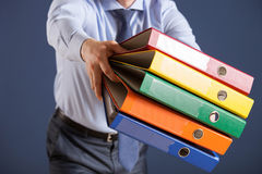 Businessman giving folders to you Stock Image