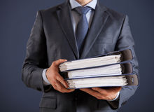 Businessman giving folders to you Stock Photography