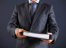 Businessman giving folders to you Royalty Free Stock Photo