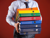 Businessman giving folders to you Royalty Free Stock Photos