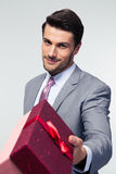 Businessman giving gift box Royalty Free Stock Image