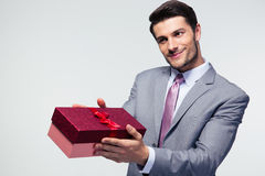 Businessman giving gift box Stock Images