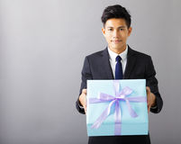 businessman giving the gift box Royalty Free Stock Photos