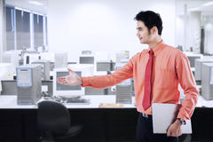 Businessman giving a hand Stock Photography