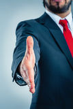 Businessman giving hand. For handshake Royalty Free Stock Images