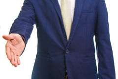 Businessman giving hand for handshake Royalty Free Stock Photos