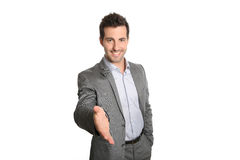 Businessman giving hand for handshake Royalty Free Stock Images