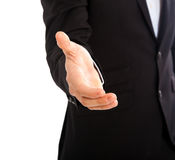 Businessman giving hand white background Stock Photography
