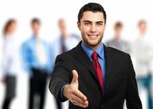 Businessman giving handshake Stock Image