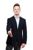 Businessman giving an handshake Stock Photo