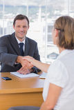 Businessman giving a handshake to a job applicant Stock Photography