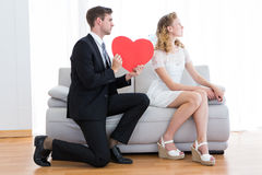 Businessman giving heart card to his girlfriend Stock Photo