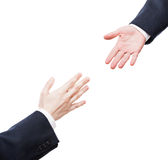 Businessman giving helping hand to business team partner. Business support and assistance concept - businessman giving helping hand to team partner white Royalty Free Stock Photo