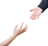 Businessman giving helping hand to poor begging needy person Royalty Free Stock Photos