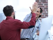 Businessman giving high five to his partner royalty free stock image