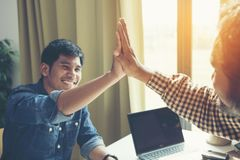 Businessman giving high five to his partner on meeting stock photos