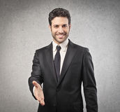 Businessman giving his hand Royalty Free Stock Images