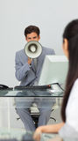 Businessman giving instructions with a megaphone Royalty Free Stock Photo