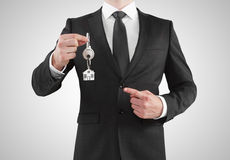 Businessman giving a key Royalty Free Stock Photo
