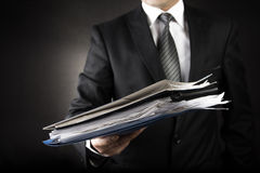 Businessman is Giving a lot of file Royalty Free Stock Images