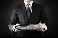 Businessman is Giving a lot of file Royalty Free Stock Image