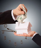 Businessman giving money cash dollars in the hands Stock Photos