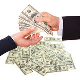 Businessman giving money cash dollars in the hands Royalty Free Stock Images