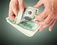 Businessman giving money cash dollars in the hands Royalty Free Stock Photos